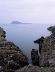Click to a larger version of Bardsey Island from St Mary's Well Cove. photo © Mick Sharp