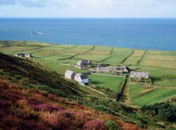 Click to a larger version of Abbey, Chapel & Farms from Bardsey Mountain. photo © Mick Sharp