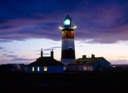 Click to a larger version of Bardsey Lighthouse. photo © Mick Sharp
